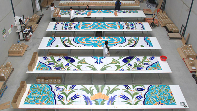 "Cerámica Artística San Ginés, in Talavera de la Reina, Toledo, Spain is one of the many manufacturers that winners have visited as part of the ""Passport to Creativity"" contest. Above, tile artists lay out a section for the world's largest hand-painted tile mural, since installed at the Oran Convention Center, in Oran, Algeria. Photo courtesy Ceramica San Ginés"