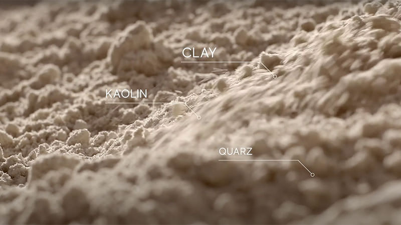 Close up of tile with tags showing clay, kaolin, and Quartz